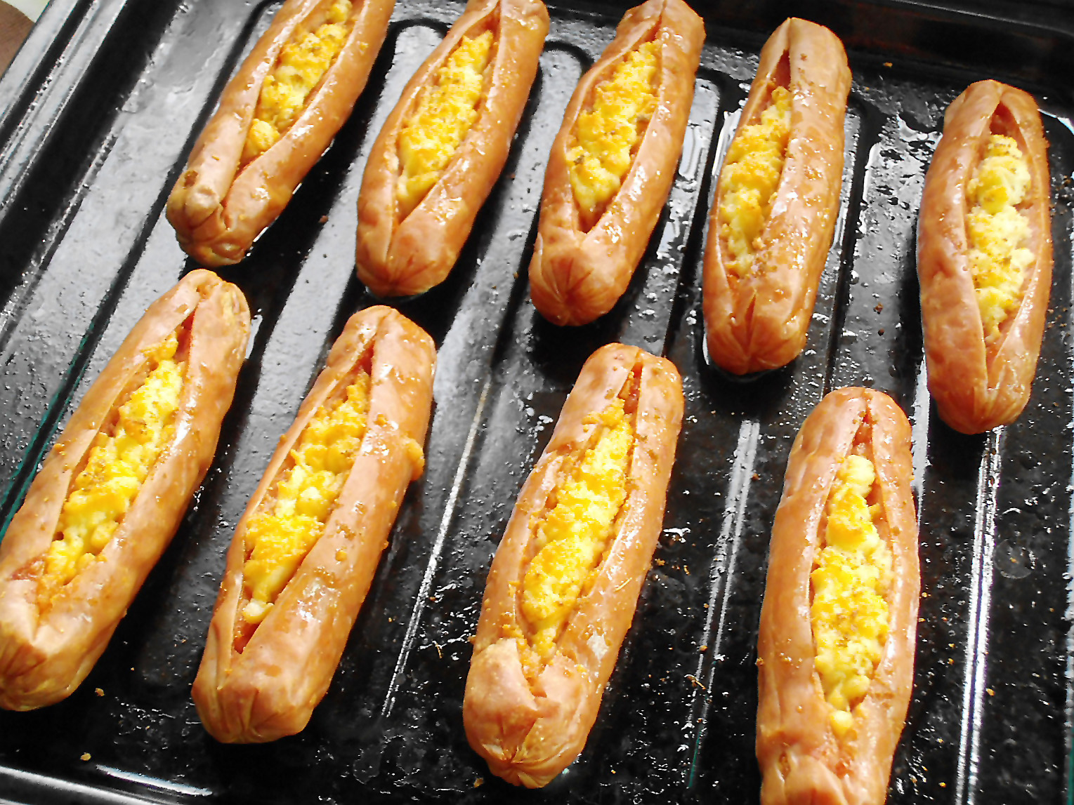 Baked sausages with cheese